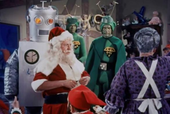 Papá Noel con personas caracterizadas de marcianos